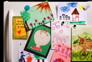 getty_rf_photo_of_child_drawings_on_refrigerator